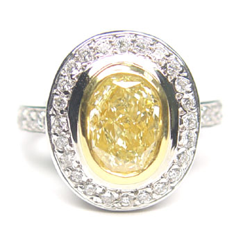 View 1.83ct Oval Fancy L. Yellow Ring
