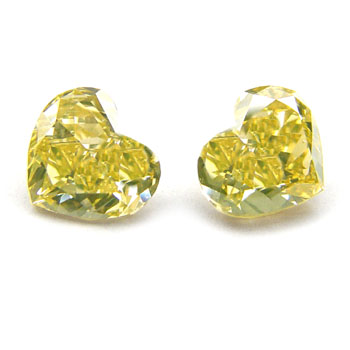 View 1.28 ct. Heart Shape Fancy br. Yellow (pair)