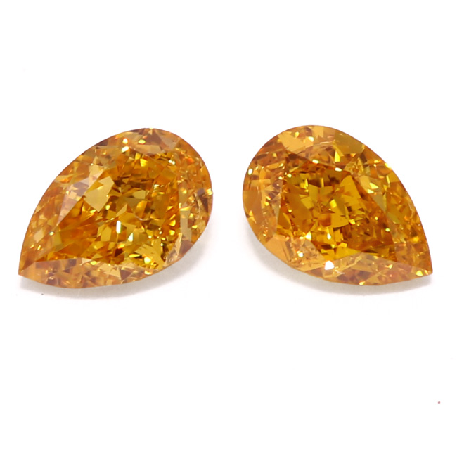 View 1.23 ct. Pear Shape Fancy Vivid Yellow-Orange (Pair)